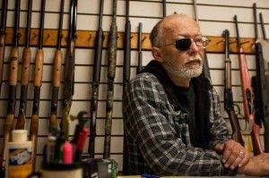 "Mike Pursell, of Murphysboro, awaits a sale Thursday at Pursell's, his buy-sell-trade shop located on Country Club Road. ""I sell all of my favorite stuff: guitars, guns and pool cues,"" he said. ""I've been here for 20 years."" Pursell said this is his second job, as he is a mechanic at the Jackson Country Club when he is not working at the store. Jessica Tezak"