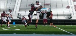 """Senior outside linebacker Kevin Reed tackles freshman tight end Josh Skadeland during football practice Tuesday at Saluki Stadium. Defensive line coach Austin Flyger said the team had a good tempo during the practice. """"It was a warm one, but they fought through,"""" Flyger said. Senior outside linebacker Jayson Dimanche said he was sweating in his cleats. """"It's a compliment to my hydration and a lot of hard work,"""" he said.Nicole Hester"""