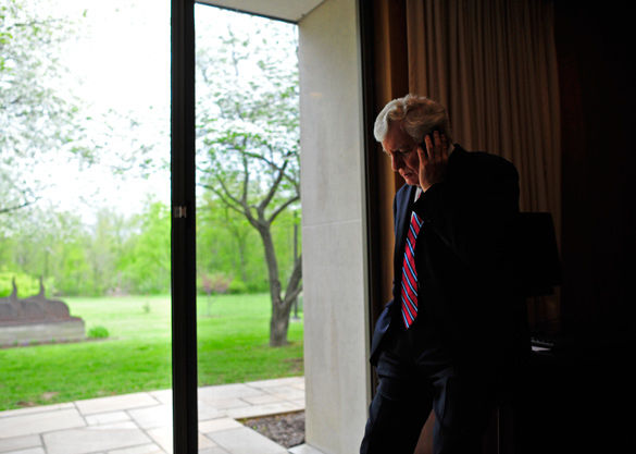 Glenn Poshard makes one of many phone calls April 30, 2014, during his last day as SIU president at the Stone Center. (Daily Egyptian file)