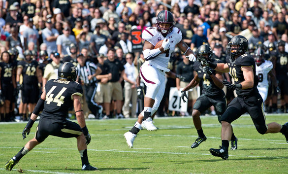 Then-SIU senior tight end MyCole Pruitt catches the ball for a first down Sept. 20, 2014, during the first half of the Salukis' 35-13 loss against Purdue University at Ross-Ade Field in West Lafayette, Ind. (DailyEgyptian.com file photo)
