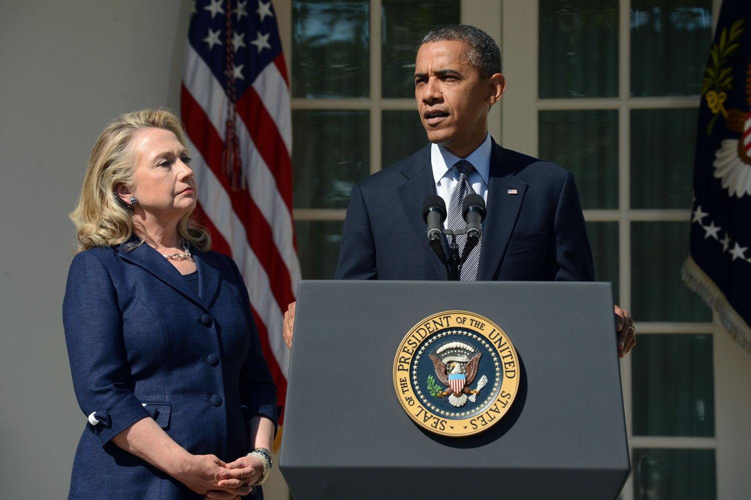 President Barack Obama delivers remarks beside Secretary of State Hillary Clinton, left, on the killing of US ambassador to Libya, Christopher Stevens, and three embassy staff, Wednesday, September 12, 2012, in the Rose Garden of the White House in Washington. (Pool photo by Michael Reynolds/EPA via Abaca Press/MCT)