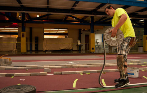 Old Recreation Center track passes the baton to a new floor