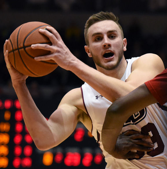 Junior forward Sean O'Brien looks to make a pass during SIU's 71-59 victory against Bradley on Feb. 17 at SIU Arena. O'Brien led the Salukis in scoring with 24 points in the game.