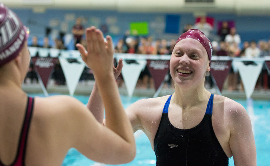 SIU+Freshman+swimmer+Kelsie+Walker+high+fives+teammate+Bryn+Handley+on+Wednesday+at+the+Edward+J.+Shea+Natatorium+during+the+first+day+of+the+MVC+Swimming+and+Diving+Championships.+The+Salukis+finished+in+the+800+Yard+Freestyle+Relay+with+40+points+and+a+time+of+7%3A18.77.%C2%A0