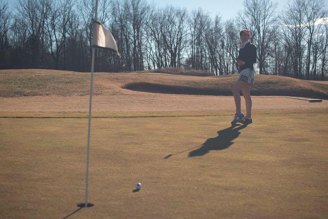 Brooke Cusumano, a then-junior from St. Louis studying accounting, practices her putting skills Feb. 1, 2016, while playing nine holes at the Hickory Ridge Golf Course in Carbondale. (DailyEgyptian.com file photo)