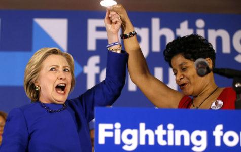 Clinton blasts Illinois governor's agenda as a return to robber baron era
