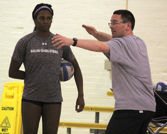 Junior middle hitter Kolby Meeks, a transfer from the University of South Alabama, watches as head coach Justin Ingram demonstrates how to serve during practice Monday, Feb. 1, 2016, in Davies Gym. Meeks said she transferred to SIU because she wasn't playing as much as she wanted to at South Alabama and felt she had a better chance playing here with a great team and coach.