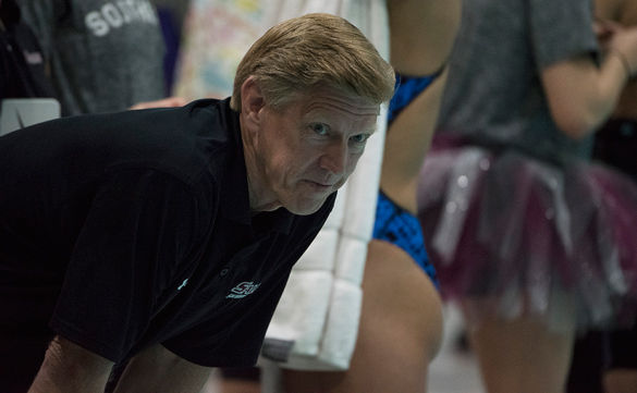 Swimming coach Rick Walker keeps a watchful eye as his swimmers perform during the 2016 Missouri Valley Conference Swimming and Diving Championships at Edward J. Shea Natatorium. SIU finished in first place on Saturday, becoming MVC Champions for the first time since 2007.