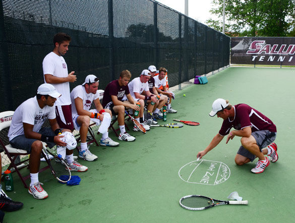 Then-SIU men's tennis coach Dann Nelson draws a diagram for his players Sept. 17, 2013 during practice at University Courts. (Daily Egyptian file photo)