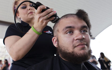 Students shave heads for cancer charity event