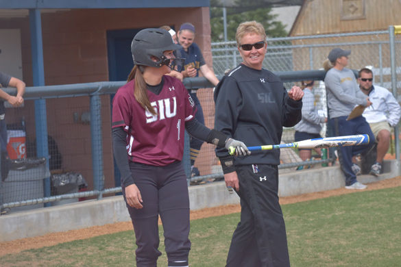 Then-junior center fielder Merri Anne Patterson smiles after a meeting with coach Kerri Blaylock on April 7, 2016  against Murray State at Racer Field in Murray, Ky. Patterson went 1-3 with an RBI and a walk in the 10-5 Saluki win.
