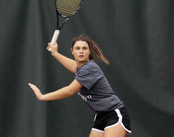 Junior Ana Sofia Cordero prepares for a hit during practice Thursday, April 30, 2016, at Sportsblast in the Garden Grove Event Center in Carbondale. (Daily Egyptian file photo)