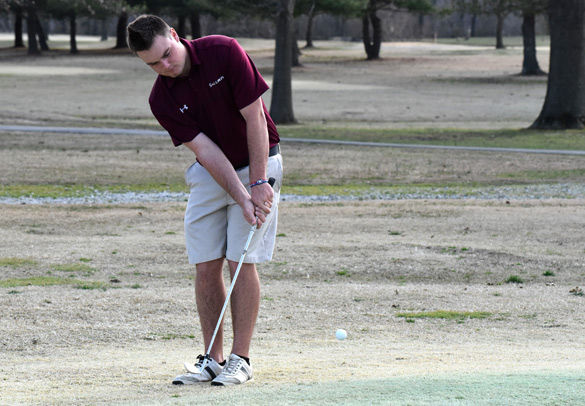 Then-junior golfer Matt Greenfield practices his chipping March 8 at Crab Orchard Golf Club in Carterville. (Sean Carley | @SCarleyDE