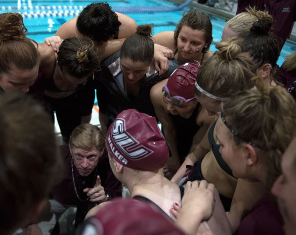 Coach Rick Walker tears up while expressing the pride he feels in the women's swim and dive team Feb. 20 after its championship-winning performance at the Missouri Valley Conference meet in Edward J. Shea Natatorium. (Morgan Timms | @morgan_timms)