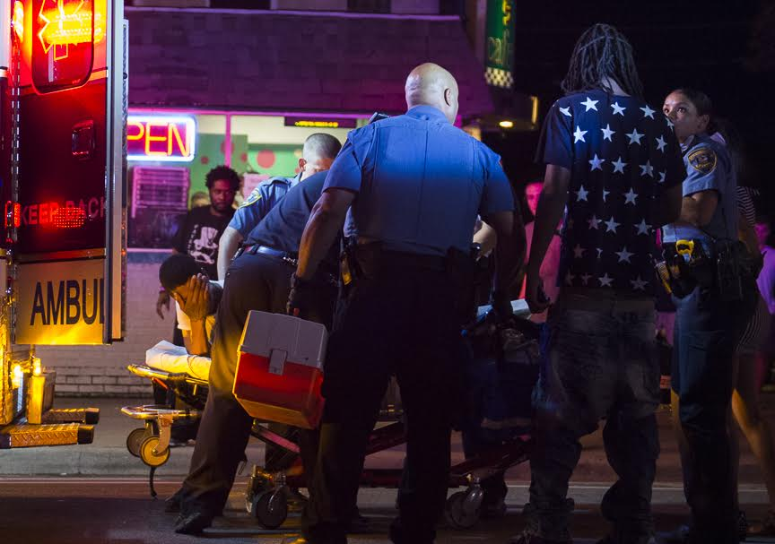 First responders load a man into an ambulance following a shooting Saturday morning near the 500 block of South Illinois Avenue. (Ryan Michalesko | @photosbylesko)