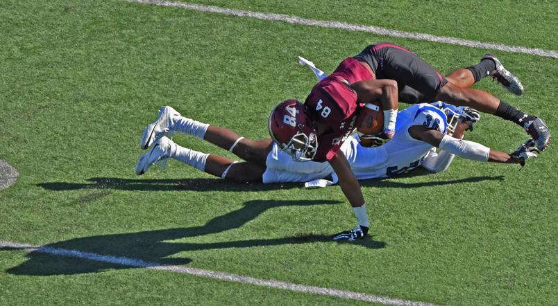 Saluki freshman wide receiver Landon Lenoir dives with the ball past Sycamore freshman defensive back Kevin Scott during SIU's homecoming game against the Indiana State Sycamores on Saturday, Oct. 22, 2016, at Saluki Stadium. The Salukis lost with a final score of 22-14. (Anna Spoerre | @annaspoerre)