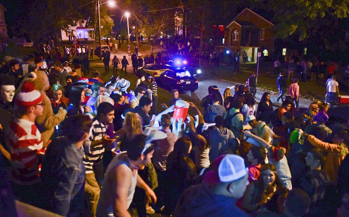 Partygoers congregate during Unofficial Halloween 2014 in Carbondale. (DailyEgyptian.com file photo)
