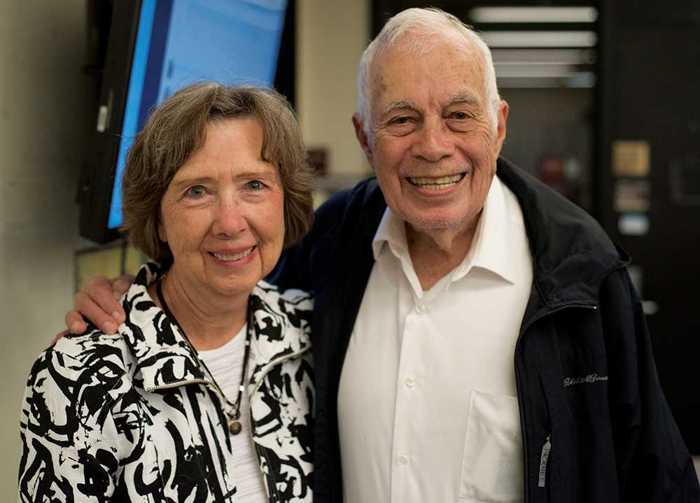 Former Editor-in-Chief Bill Hollada and his wife, Roberta Hollada, pose Friday, Oct. 21, 2016, during a newsroom tour in celebration of the Daily Egyptian's 100-year anniversary. (Morgan Timms | @Morgan_Timms)