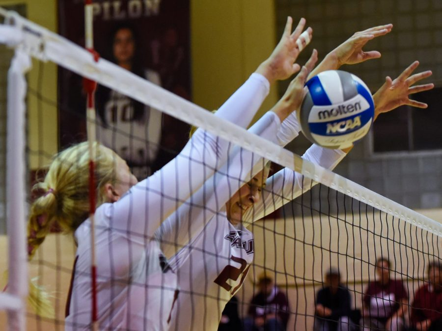 Junior+outside+hitter+Nellie+Fredriksson%2C+left%2C+and+junior+middle+hitter+Alex+Rosignol+go+for+a+block+during+Loyola%27s+3-1+victory+against+the+Salukis+on+Friday%2C+Oct.+28%2C+2016%2C+in+Davies+Gym.+%28Sean+Carley+%7C+%40SCarleyDE%29+