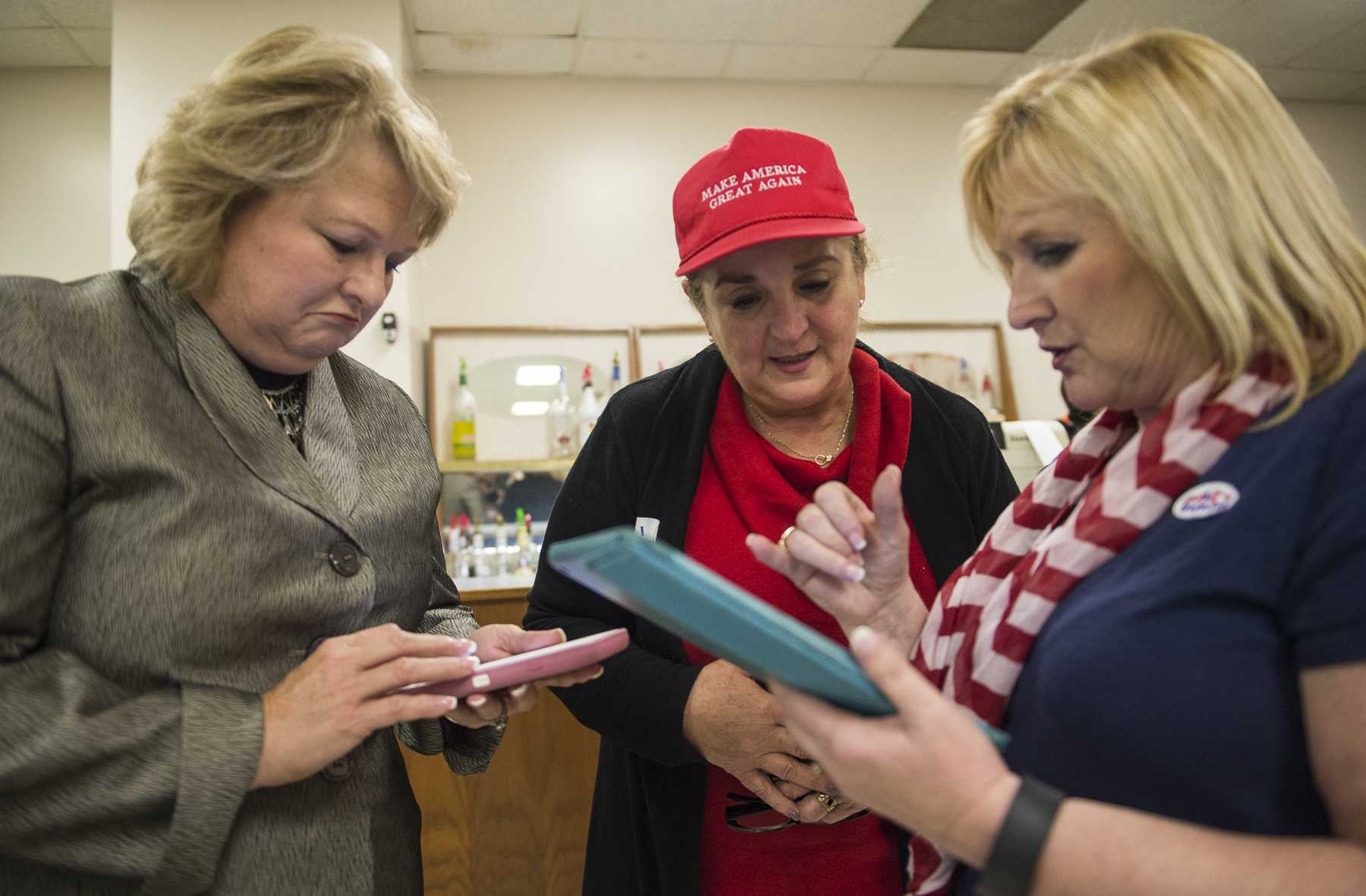 From left: Illinois State Rep. Terri Bryant, Gloria Campos and Debbie Pittman read through election results at a U.S. Rep. Mike Bost and Illinois State Rep. Terri Bryant victory party Tuesday, Nov. 8, 2016, at the Elks Lodge in Murphysboro. (Ryan Michalesko | @photosbylesko)