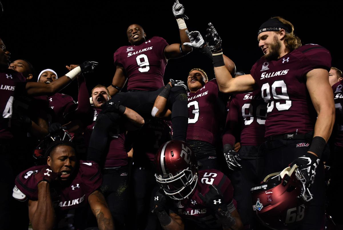 Saluki football players celebrate after their 44-34 win against Western Illinois on Saturday, Nov. 19, 2016, at Saluki Stadium. (Athena Chrysanthou   @Chrysant1Athena)