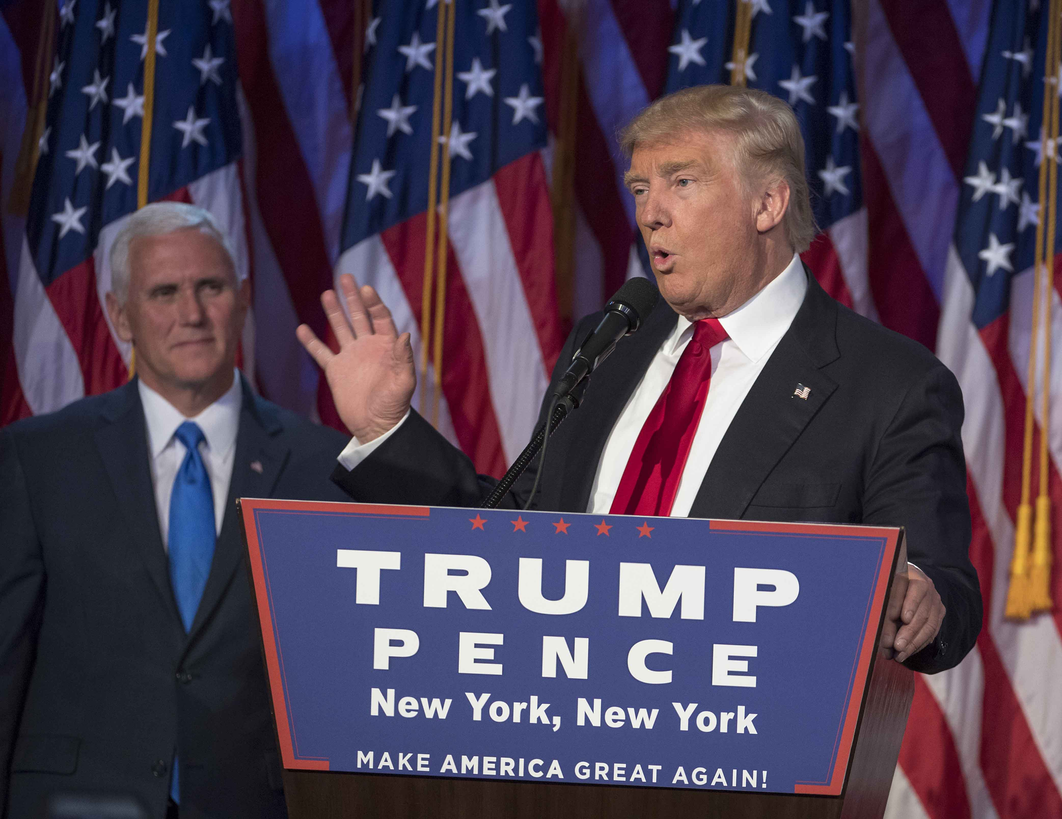 President-elect Donald Trump, joined on stage by running mate Mike Pence, speaks to supporters at the Election Night Party at the Hilton Midtown Hotel in New York City on Wednesday, Nov. 9, 2016. (J. Conrad Williams Jr./Newsday/TNS)