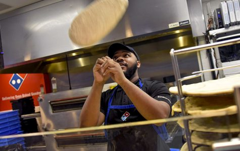 Photo of the Day: Tossing pizza dough like a King