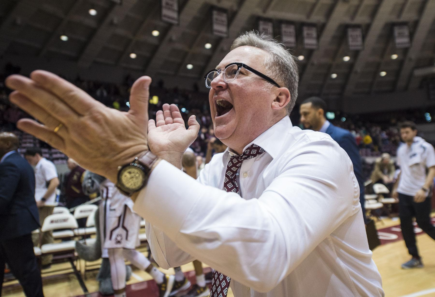 Coach Barry Hinson celebrates following the Salukis' 80-74 overtime win against the Indiana State Sycamores on Wednesday, Jan. 4, 2017, at SIU Arena. (Ryan Michalesko | @photosbylesko)