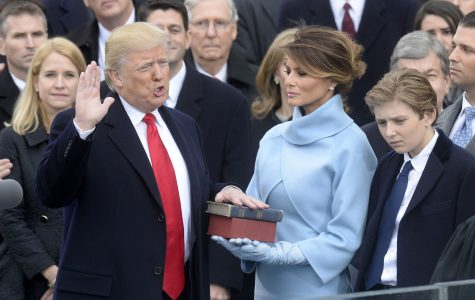 Trump is sworn in as president, a divisive, singular figure promising to lift up 'the forgotten'