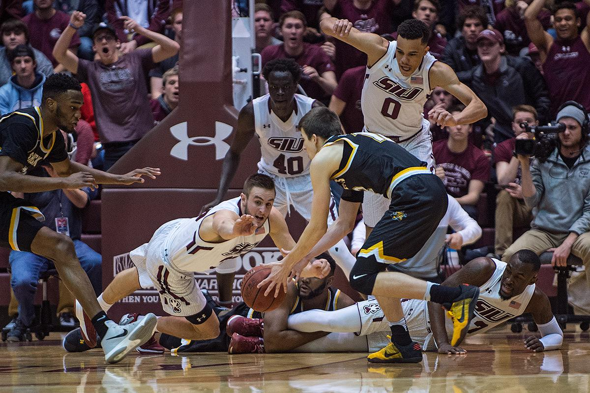Salukis and Shockers scramble for the ball during SIU's 87-68 loss to Wichita State on Wednesday, Feb. 15, 2017, at SIU Arena. (Jacob Wiegand | @jawiegandphoto)