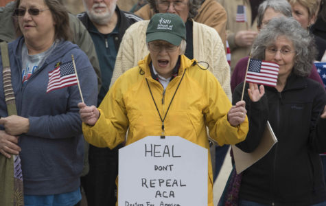 Protesters demand Rep. Bost defend Affordable Care Act