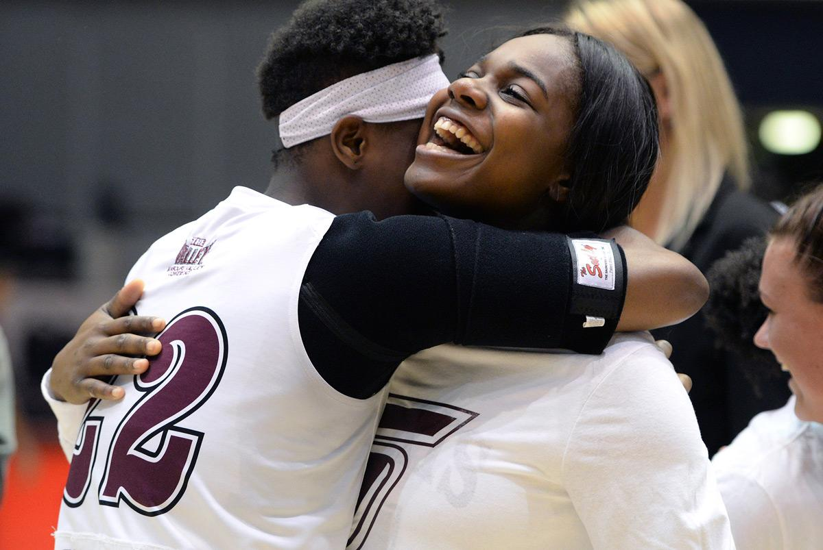 Freshman guard/forward Tiajaney Hawkins hugs senior forward Kim Nebo on Sunday, Feb. 26, 2017, after SIU's 69-63 win over Bradley at SIU Arena. Nebo, who was recognized as one of the team's senior players after the game, scored 14 points and grabbed 10 rebounds in her last home game. (Luke Nozicka | @lukenozicka)