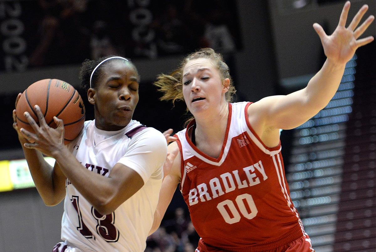 Senior point guard Rishonda Napier drives to the basket Sunday, Feb. 26, 2017, during SIU's 69-63 win over Bradley at SIU Arena. Napier scored 10 points and had seven assists in her last home game. (Luke Nozicka   @lukenozicka)