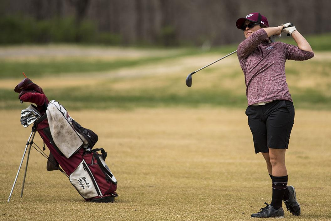 Junior Jackie Biggs watches the ball after teeing off Sunday, March 26, 2017, during the first day of the Saluki Invitational at Hickory Ridge Golf Course in Carbondale. (Branda Mitchell | @branda_mitchell)