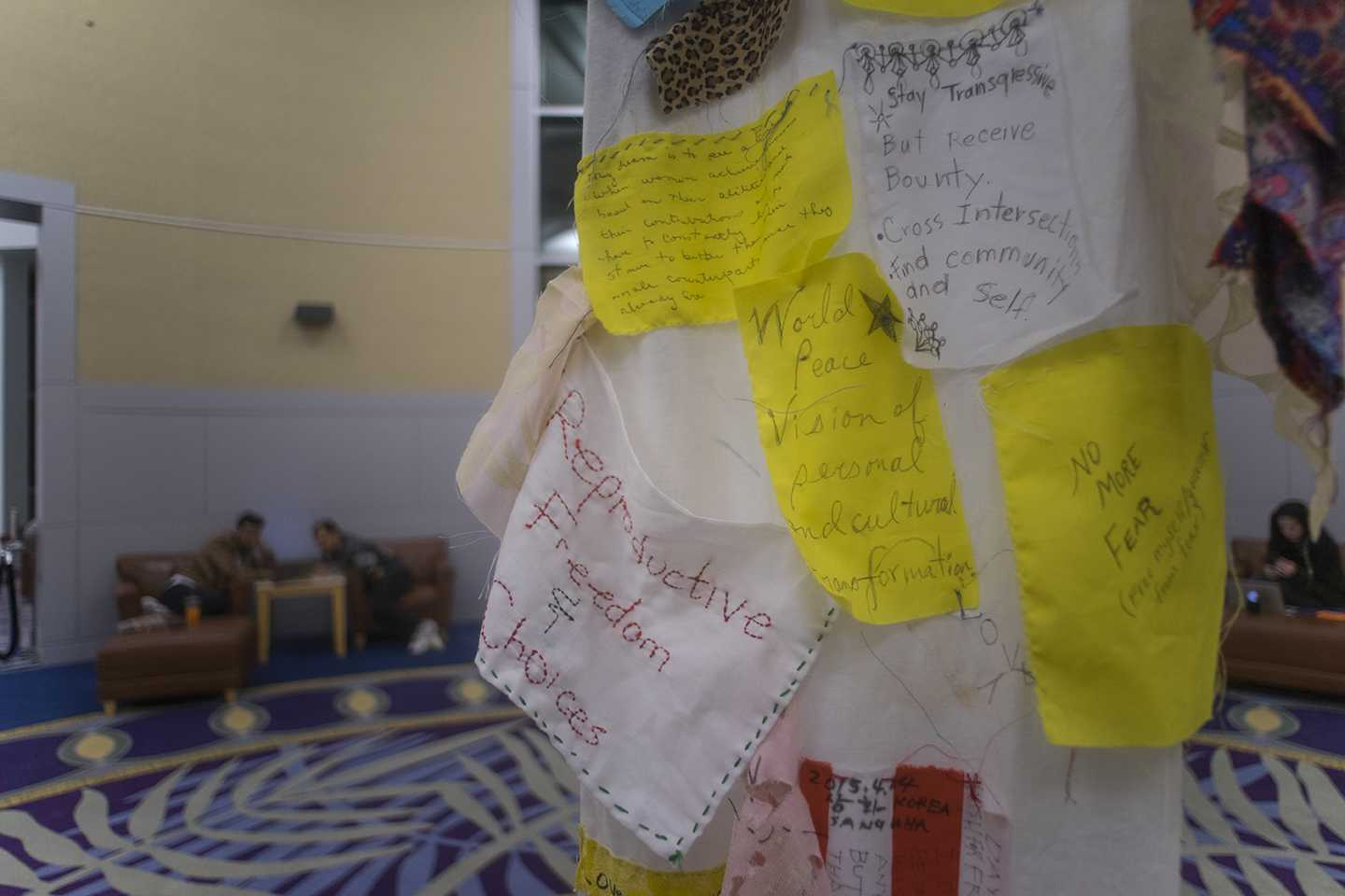 """A scroll adorned with handwritten notes hangs Monday, March 6, 2017, in the Morris Library rotunda. The """"Dreaming Diversity and Art Display"""" is a three-week interactive installation. (Branda Mitchell 
