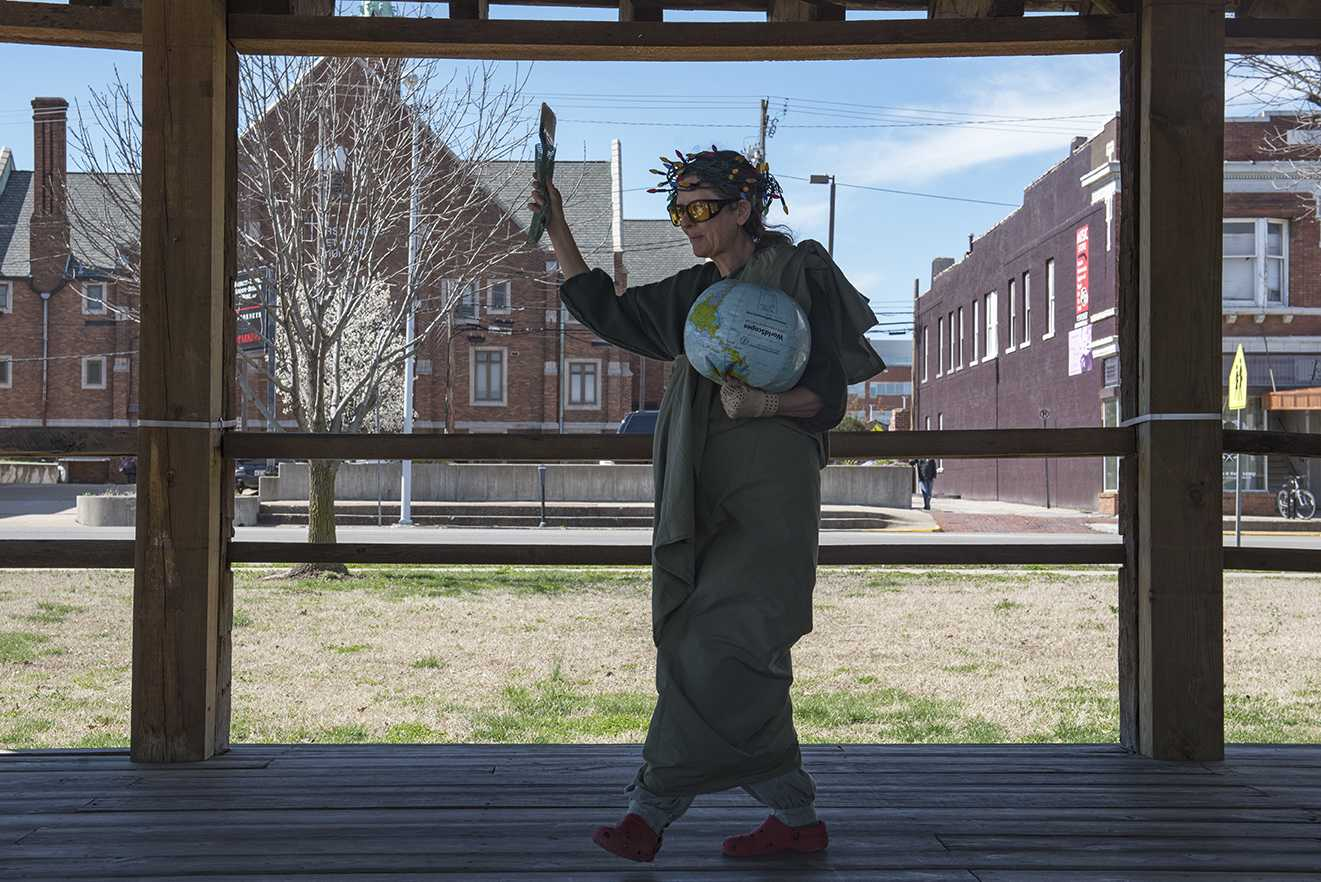 "Deborah Bouton, dressed as Lady Liberty, attends the ""A Day Without a Woman"" rally Wednesday, March 8, 2017, in the Carbondale Town Square Pavilion. She said holding the globe upside down is metaphor for the country. ""The globe is 80 percent water,"" she said. ""And when a diver is in distress, the boat will fly the flag upside down."" (Branda Mitchell 