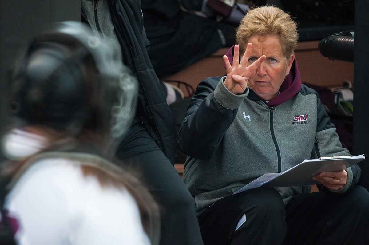 Coach Kerri Blaylock signals to freshman catcher Katelyn Massa during SIU's 9-3 loss to the Northern Illinois Huskies on Sunday, March 5, 2017, at Charlotte West Stadium. (Jacob Wiegand | @jawiegandphoto)