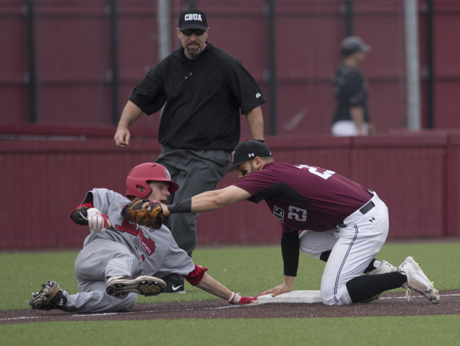 Gamecock+junior+infielder+Taylor+Hawthorne+attempts+to+slide+back+to+safety+Friday%2C+March+24%2C+2017%2C+as+Saluki+senior+infielder+Ryan+Sabo+holds+the+ball+at+third+base.+The+umpire+called+Hawthorne+out.+Jacksonville+State+went+on+to+beat+SIU+8-6+during+the+first+of+a+three-game+series+at+Itchy+Jones+Stadium.+%28Bill+Lukitsch+%7C+%40lukitsbill%29