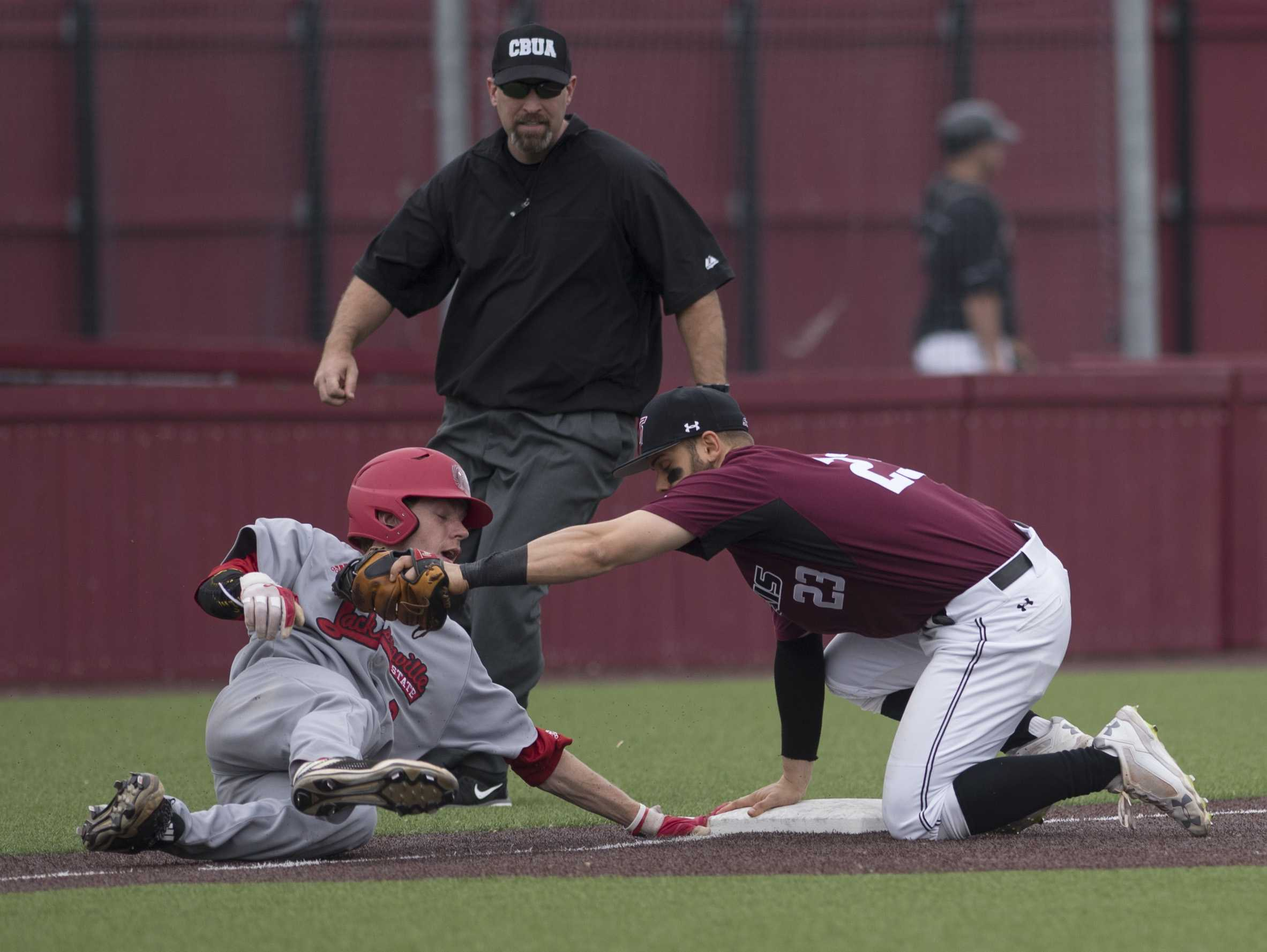 Gamecock junior infielder Taylor Hawthorne attempts to slide back to safety Friday, March 24, 2017, as Saluki senior infielder Ryan Sabo holds the ball at third base. The umpire called Hawthorne out. Jacksonville State went on to beat SIU 8-6 during the first of a three-game series at Itchy Jones Stadium. (Bill Lukitsch | @lukitsbill)