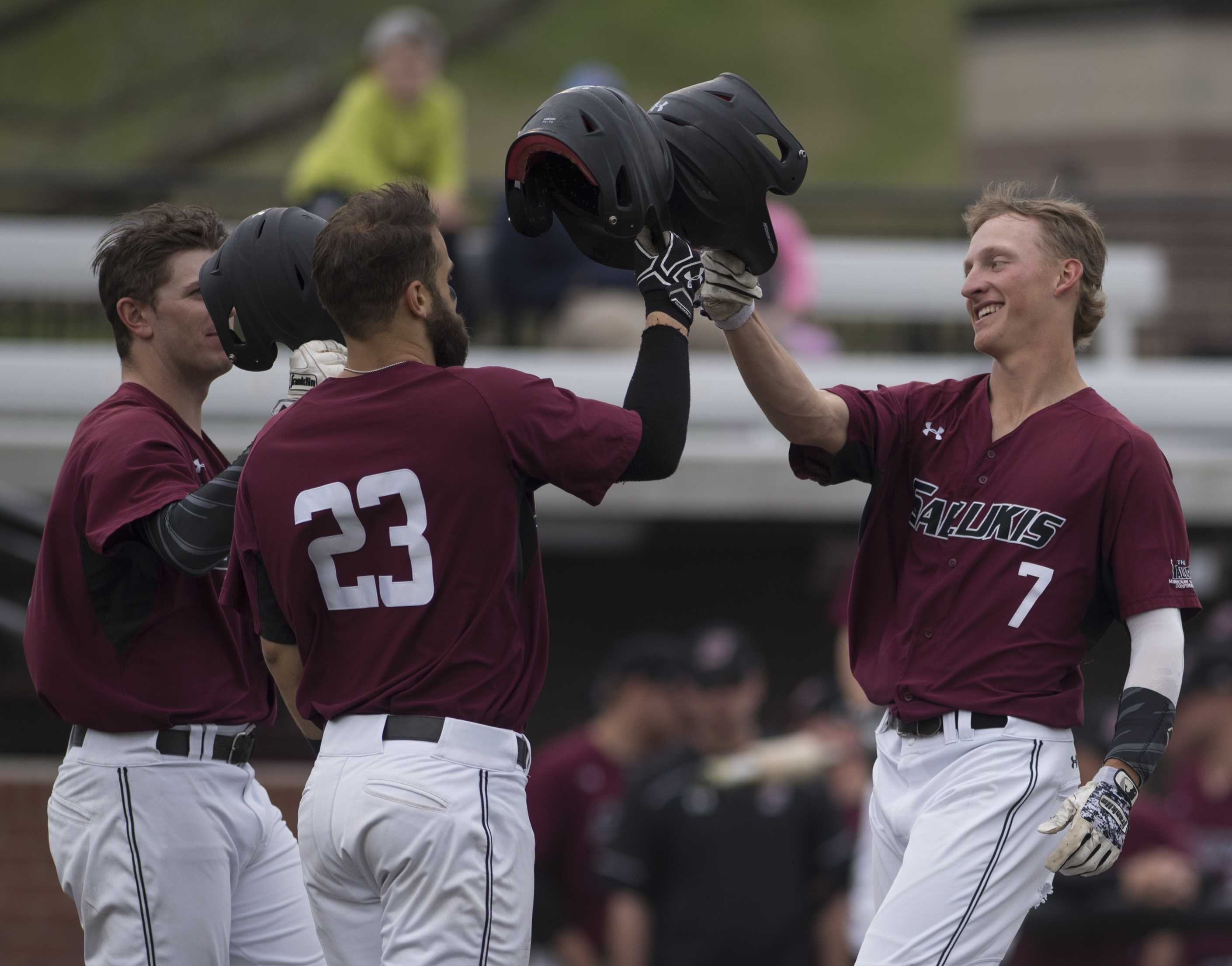 Junior infielder Connor Kopach (7) celebrates after hitting a two-run home run Friday, March 24, 2017, alongside senior infielder Ryan Sabo (23) and senior infielder Will Farmer. The Jacksonville State Gamecocks went on to beat SIU 8-6 during the first of a three-game series at Itchy Jones Stadium. (Bill Lukitsch | @lukitsbill)