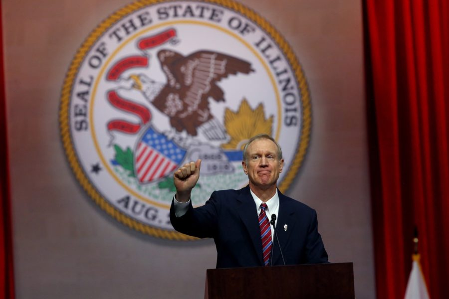 Gov.+Bruce+Rauner+gives+a+thumbs+up+after+giving+his+first+speech+as+governor+on+Monday+Jan.+12%2C+2015+at+the+Prairie+Capital+Convention+Center+in+Springfield%2C+Ill.+%28Nancy+Stone+%7C+Chicago+Tribune%29