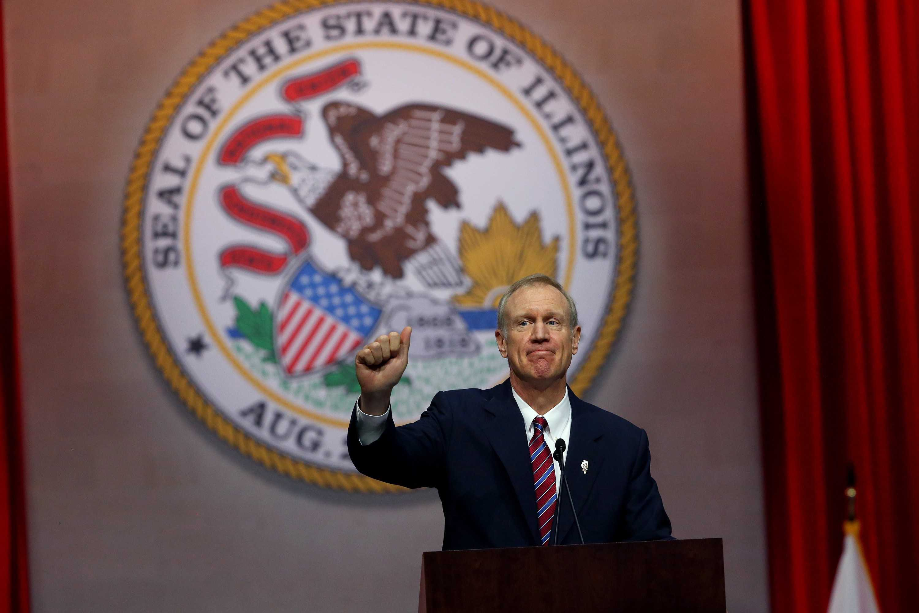 Gov. Bruce Rauner gives a thumbs up after giving his first speech as governor on Monday Jan. 12, 2015 at the Prairie Capital Convention Center in Springfield, Ill. (Nancy Stone | Chicago Tribune)