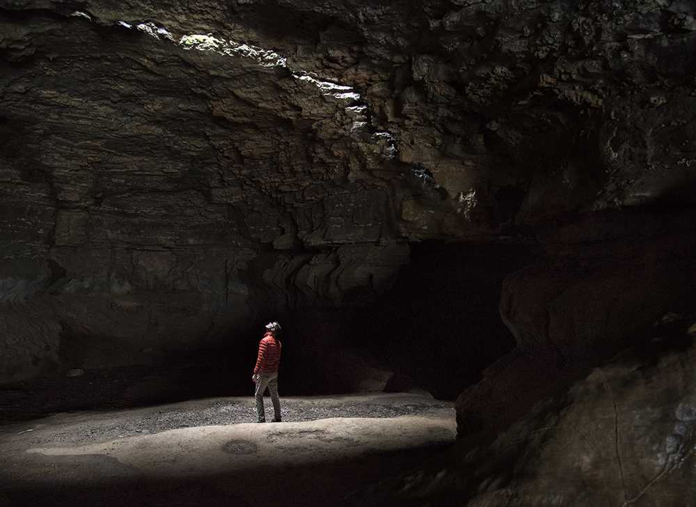 "Jack Gebert, 24, of Crystal Lake, gazes up at the light spilling through a shaft inside the famous 55-foot-wide riverside cave March 17 at Cave-In-Rock State Park by the Ohio River. Gebert traveled to the cave with his 20-year-old brother, Daniel, while the two was on a three-day camping trip in the Shawnee National Forest. It was the brothers' first time at the state park. ""This place is really impressive,"" Gebert said. ""Obviously there are pictures on the internet of the cave, but actually being in it is just so awesome."""