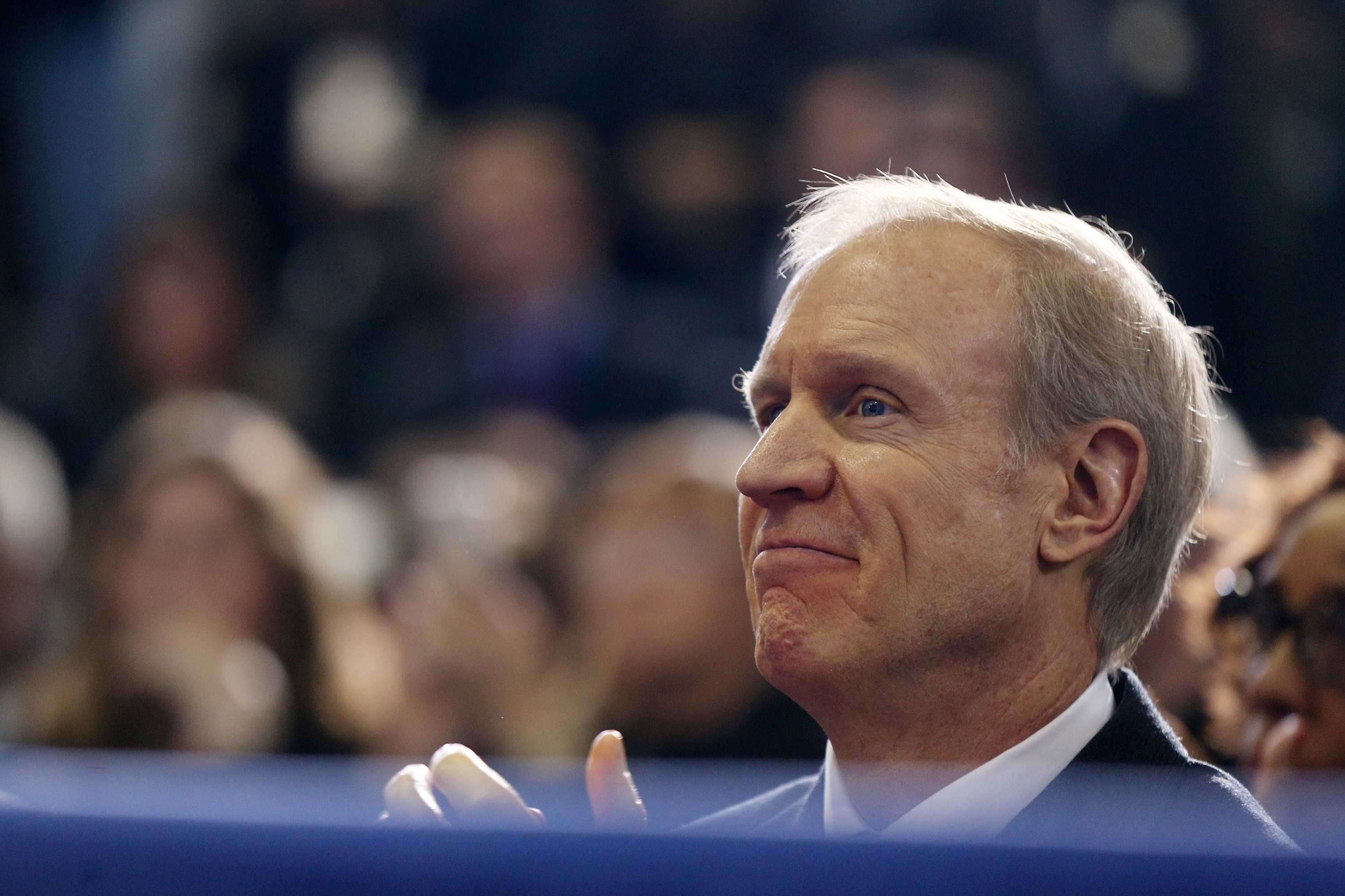 Gov. Bruce Rauner watches from his seat in the audience as President Barack Obama speaks on the designation of the Pullman National Monument Thursday, Feb. 19, 2015 at Gwendolyn Brooks College Preparatory Academy in Chicago. (Anthony Souffle | Chicago Tribune | TNS)