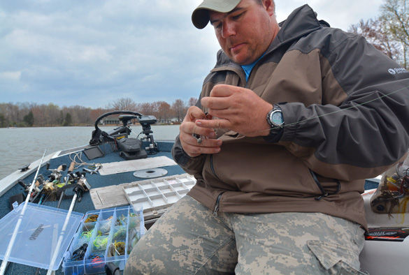 Aaron Connor, a senior from Murphysboro studying human nutrition and dietetics, fishes Sunday during the fifth-annual Saluki Bassers Veterans Appreciation Fishing Tournament at Lake of Egypt in Marion. Connor, a veteran of the U.S. Army and member of the Saluki Bassers, was one of several student veterans who participated in the tournament. He said it was great to be back on the water again.