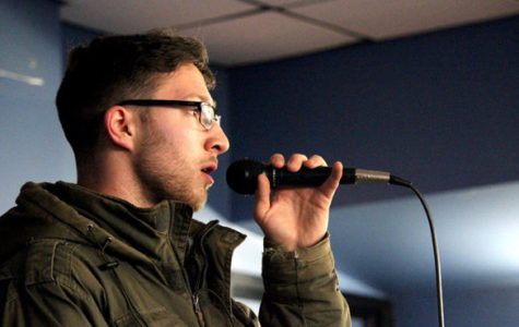 """Then-sophomore Aidan Dolik performs an acapella cover of """"I Don't Want to Set the World on Fire"""" in Lentz Hall. (DailyEgyptian.com file photo)"""