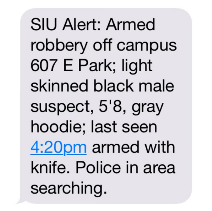 Armed robbery on East Park Street. Suspect armed with knife last seen at 4:20 p.m. Sunday. Police in area searching.