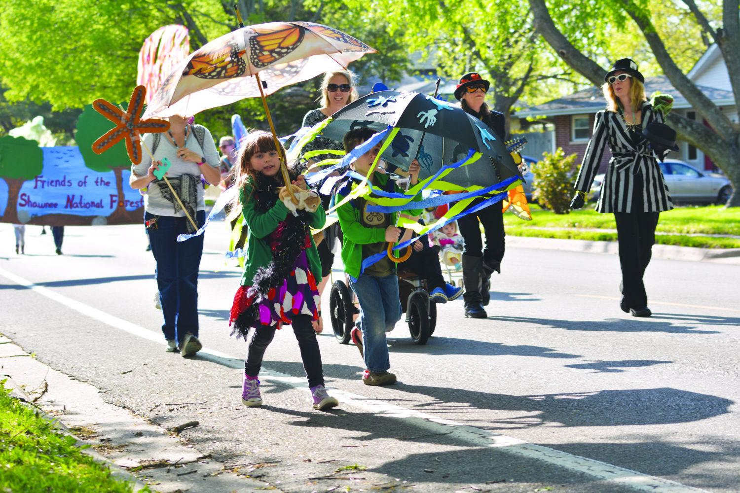 People with costumes and puppets march down North Glenview Drive in 2015 during the second All Species Puppet Parade in Carbondale. The focus is to raise awareness of the necessary coexistence of species. Lisa Barnes, a Beloved Puppetista and a local artist, said one goals of the All Species Puppet Parade is to show kids the relevance of having a sustainable earth.