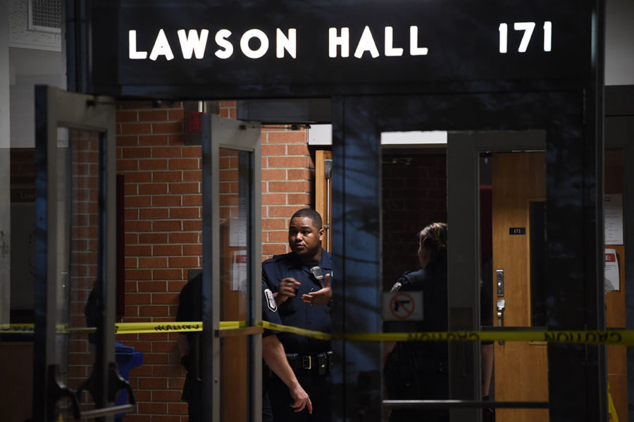 Police converse in April 2015 inside Lawson Hall. (DailyEgyptian.com file photo)