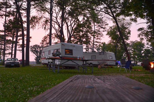 The sun sets over the Crab Orchard Lake Campgrounds Saturday. The lake was originally created in the 1930s by the damming of the Crab Orchard Creek, a tributary of the Big Muddy River, for recreation and flood control. Two camping areas are available on the north side of the lake, the Blue Heron Campground and the Crab Orchard Lake Campground.